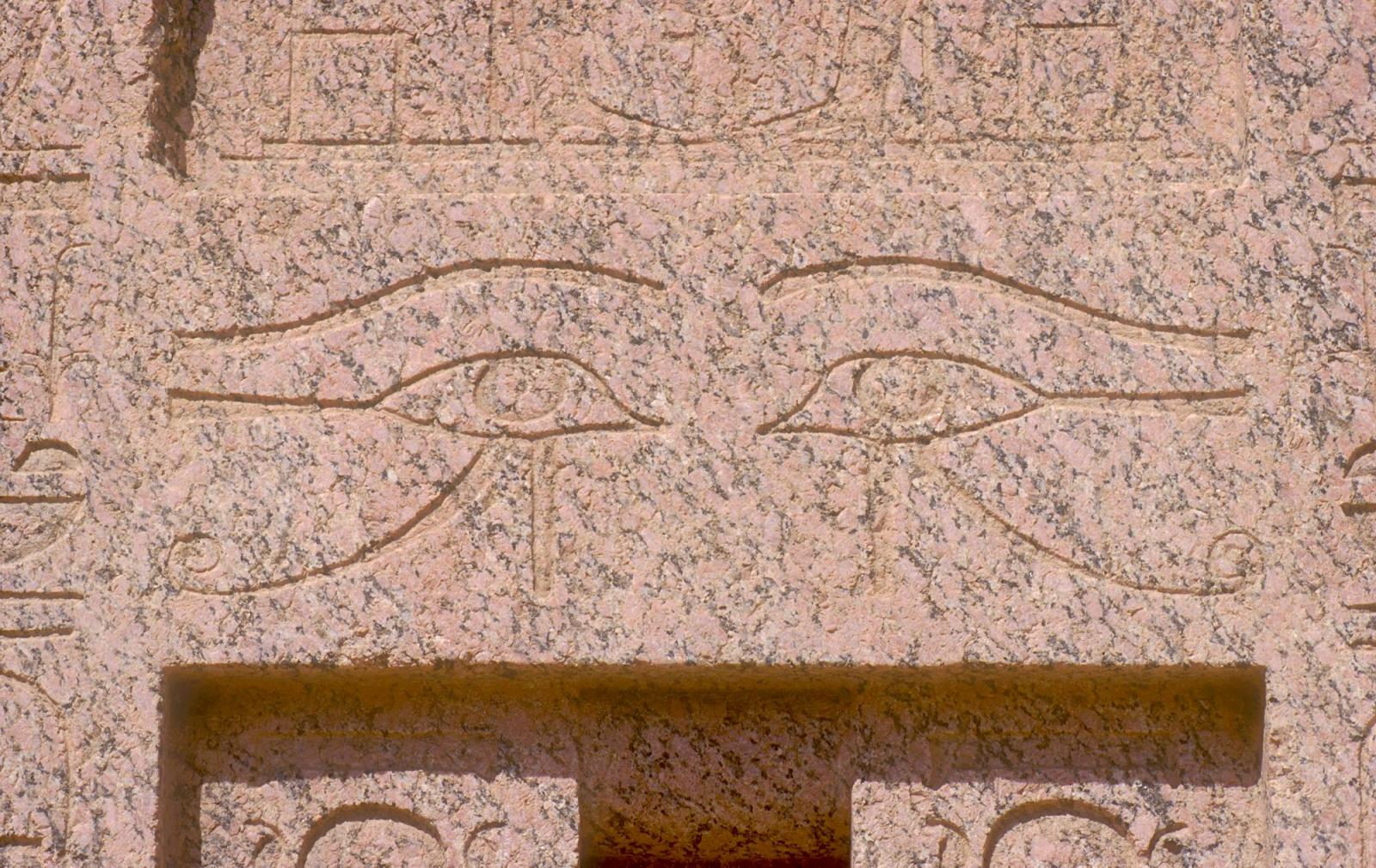 Madinat Habu, Roman forecourt of Amen temple, granite false door from Memorial temple of Thutmes III, detail: pair of Horus eyes