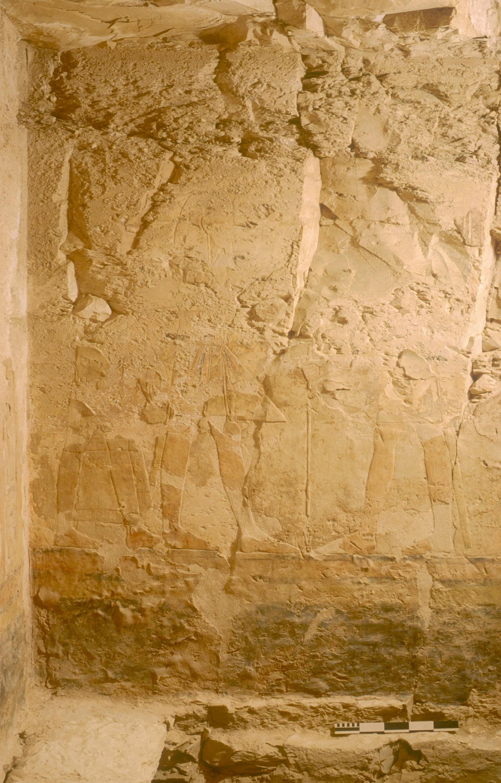 Painted relief on wall after cleaning: Rameses II with prince before deity.