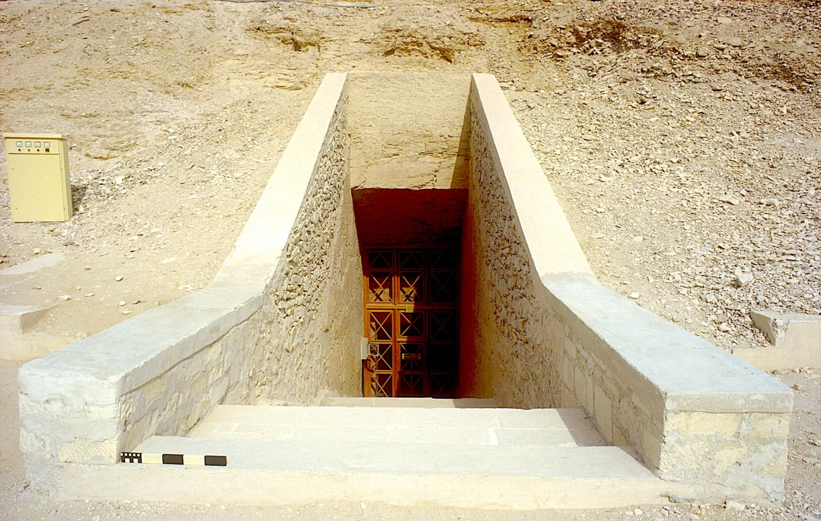 Tomb entrance, with modern revetments and steps.