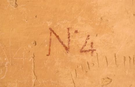 Wilkinson's painted tomb number and graffiti.