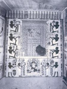 The south wall of the Dynasty 18 tomb of the scribe Nakht. Three rows of offering bearers on the sides and two additional bearers accompanied by tree goddesses below hold food and supplies. These are directed toward a false door.