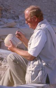 Dr. Kent Weeks inspecting a canopic jar.