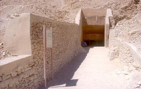 Modern approach to tomb entrance, with old information sign.