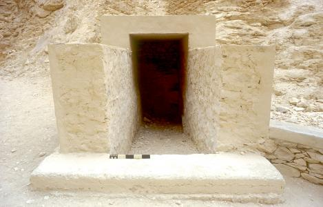 Tomb entrance inside modern covering.