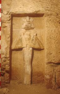 Osiris carved in high raised relief in recess.